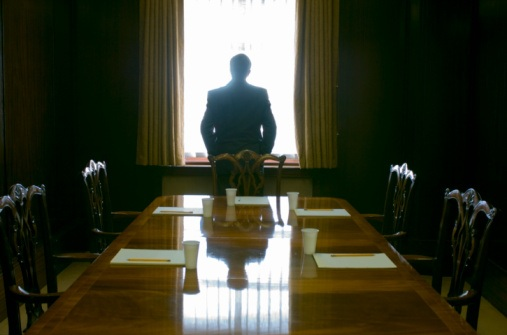 lonely-at-the-top-man-in-boardroom